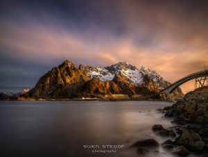 Snowy mountains above Henningsvaer village in sunrise light, Lofoten